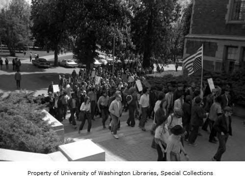 Protestors_carrying_an_American_flag_at_a_rally_on_the_University_of_Washington_campus_May_7_1970