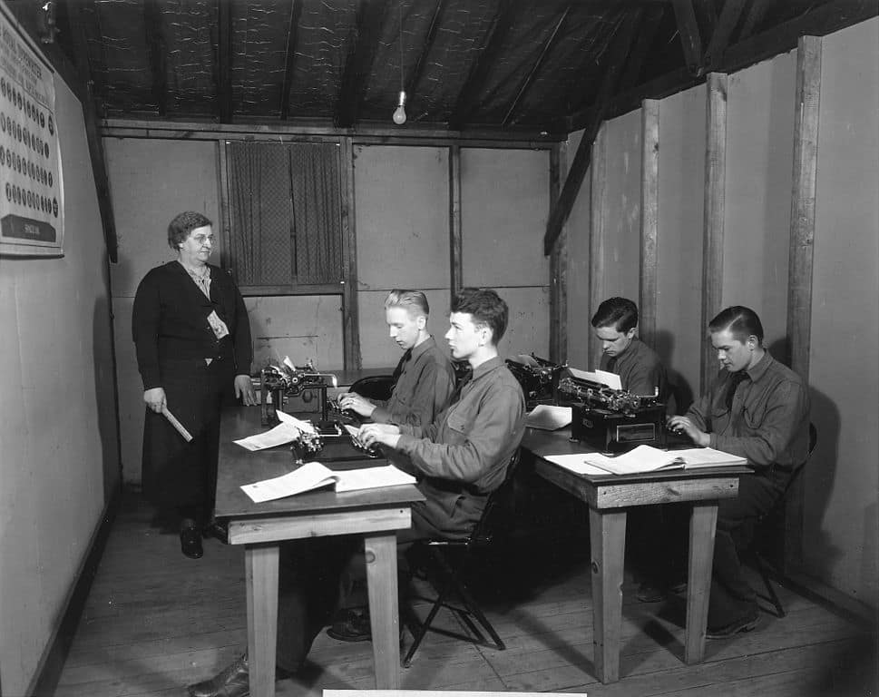 Civilian_Conservation_Corps,_Third_Corps_Area,_typing_class_with_W.P.A._instructor_-_NARA_-_197144